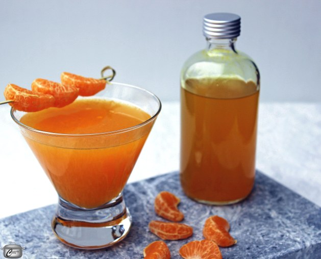 A turmeric and ginger infused simple syrup with freshly squeezed orange juice and vodka makes a delicious and nutritious cocktail!
