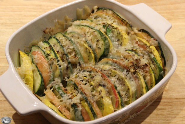 Sliced apples and zucchini are topped with minced onion, herbs and cheese for this delicious tian.