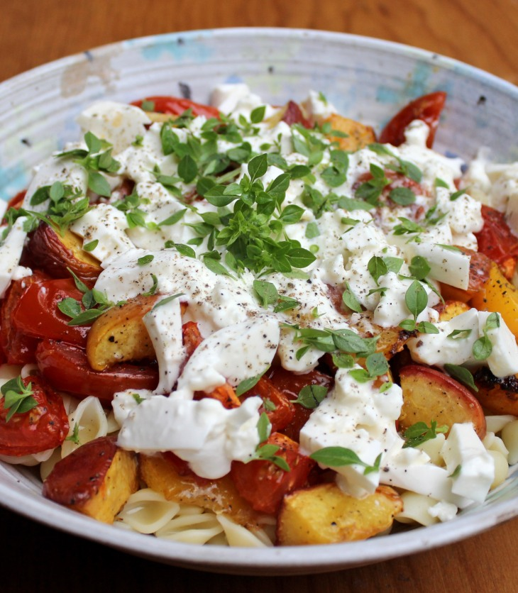 This quick vegetarian pasta dish features roasted tomatoes and peaches plus delicious burrata cheese