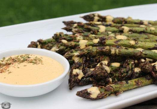 Grilling is an easy way to prepare asparagus and this creamy harissa sauce adds a ton of flavour