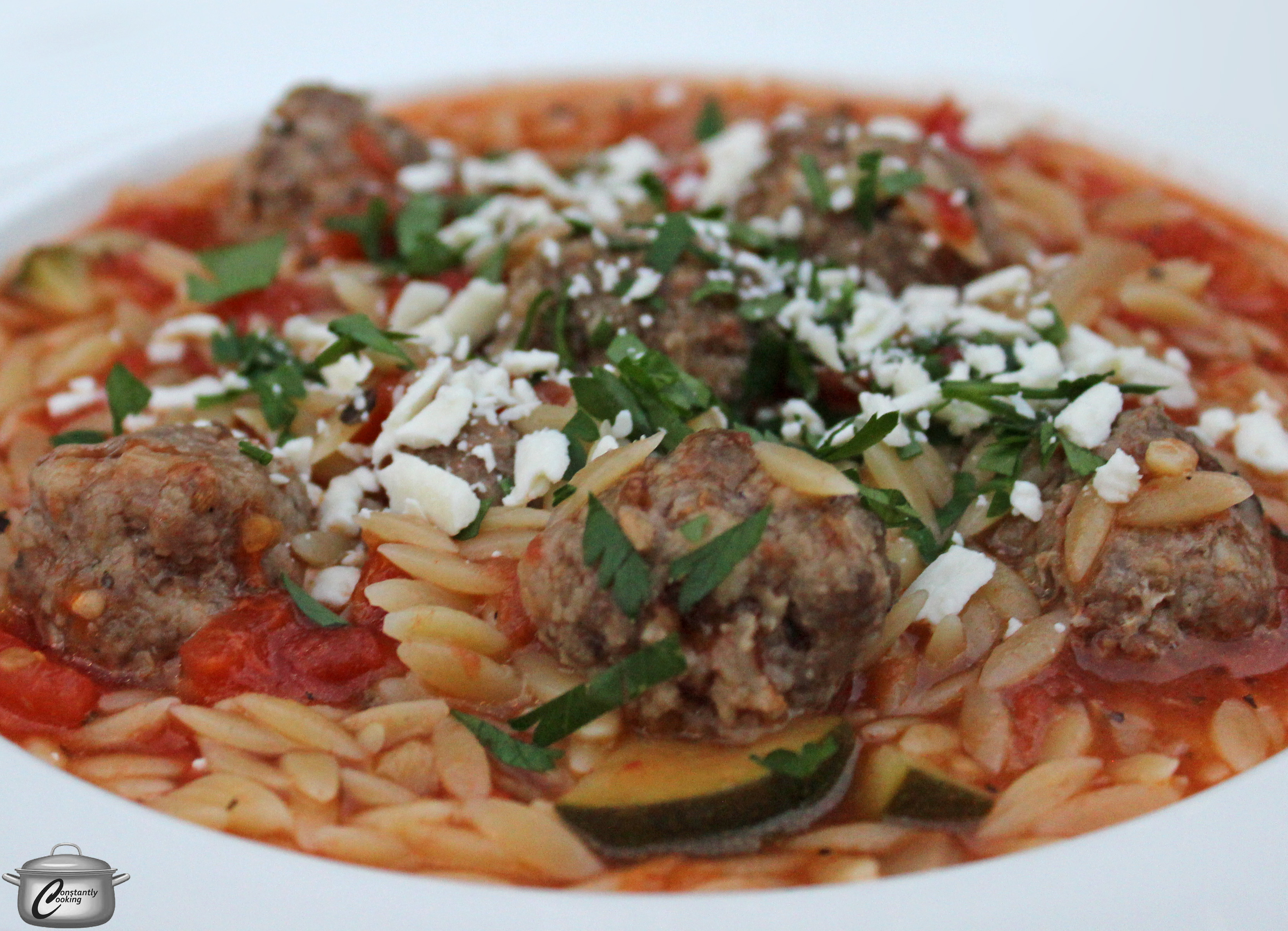 Spiced lamb meatball stew with orzo and vegetables ...