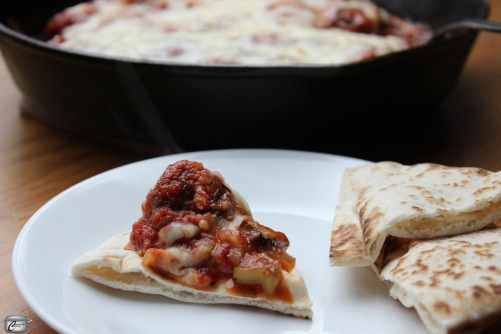 a piping hot dish of meatballs, pizza sauce, vegetables and cheese makes an excellent dip