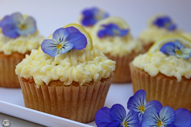 cupcakes made with hard iced tea malt beverage topped with lemon buttercream