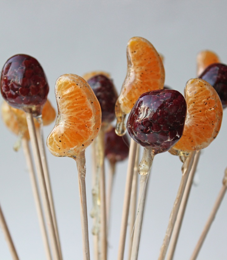 A simple hard-crack sugar syrup is the perfect way to coat pieces of fruit to turn them into lollipops!