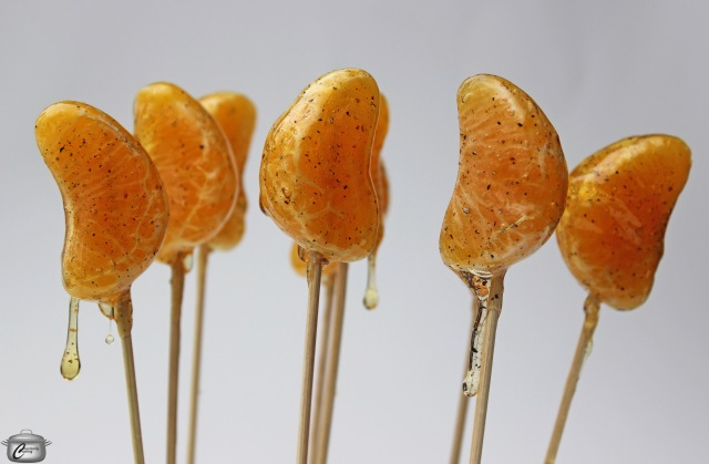 Cardamom-scented sugar syrup hardens beautifully on fresh fruit to create delicious lollipops.