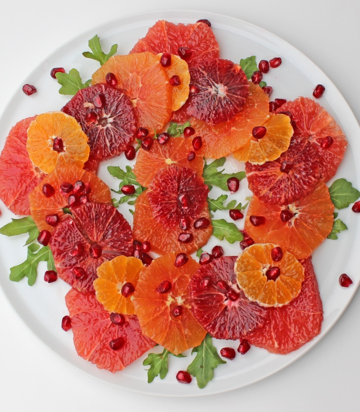 A mix of citrus fruits with arugula and pomegranate plus a light lemon vinaigrette makes for a delicious winter salad