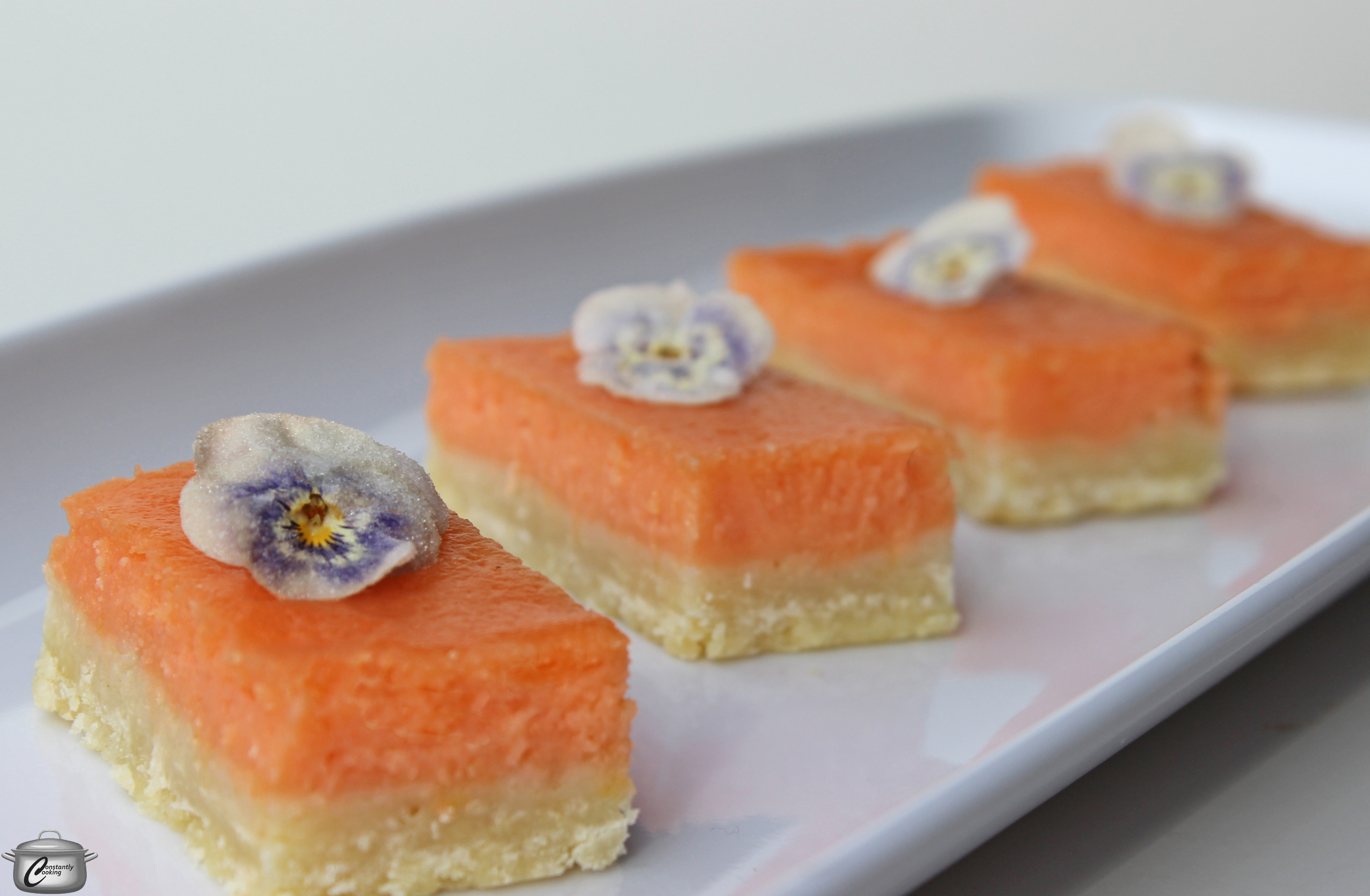 Tangy grapefruit and vanilla custard layered over a shortbread base make for a truly delicious dessert