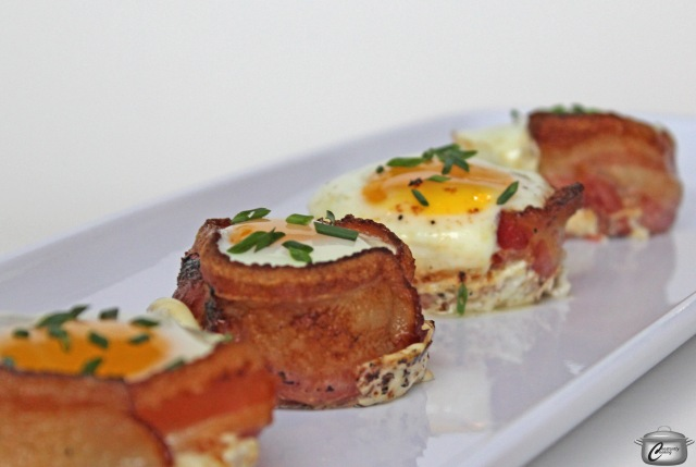 Bake up these tasty bites made of crispy bacon and a perfectly cooked egg in the middle.