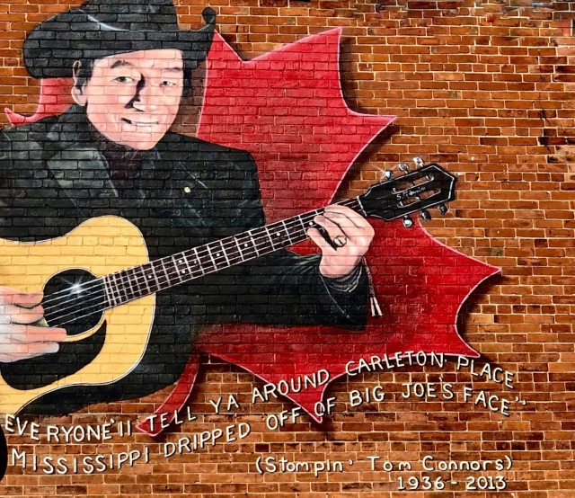 The mural of Stompin' Tom Connors beside the Grand Hotel is one of many delightful pieces of public art to be found in Carleton Place.