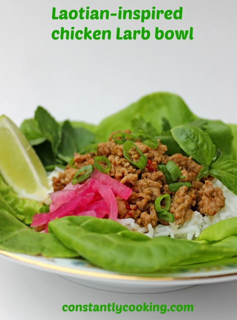 seasoned ground meat with pickled onions, lettuce and fresh herbs